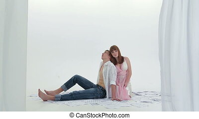 Young Romantic Couple Sitting On the Floor