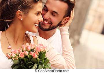 Young romantic couple with flowers