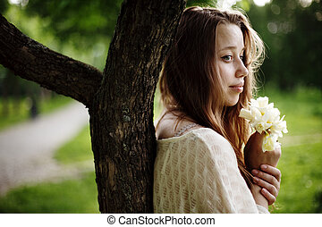 Young romantic woman standing alone
