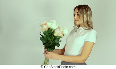 Young romantic woman with bouquet o
