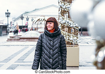 Young russian woman on a Red Square close to Kremlin. Moscow city.