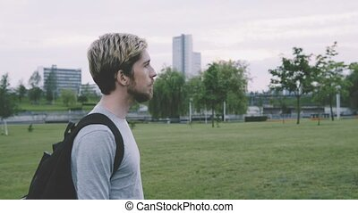 Young sad man walking