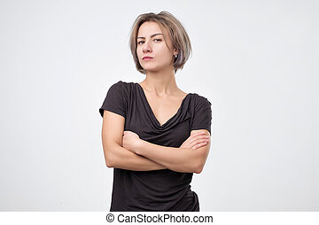 Young sad or serious european woman in studio