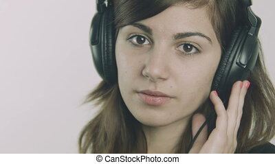 Young sad woman with headphones