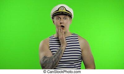 Young sailor man expresses shock, looks surprised. Seaman ...
