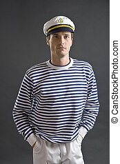 Young sailor man with white sailor hat