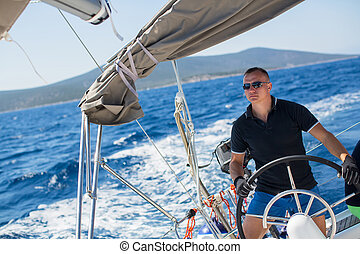skipper manages sailing vessel - Young sailor skipper...
