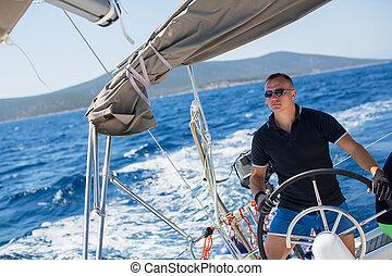 skipper manages sailing vessel - Young sailor skipper...