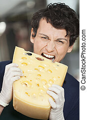 Young Salesman Eating Cheese In Store
