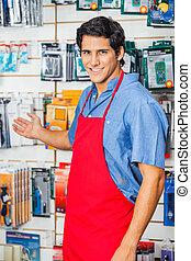 Young Salesman Welcoming At Hardware Shop