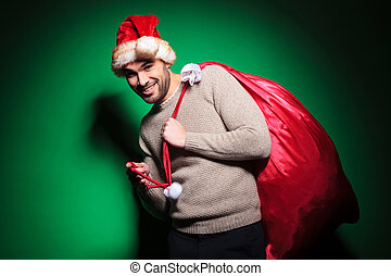 santa man is playing with the bag
