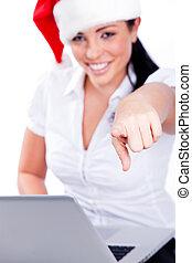 Young santa woman pointing at the camera
