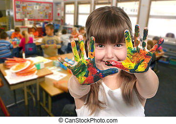 School Age Child Painting With Her Hands in Class - Young...
