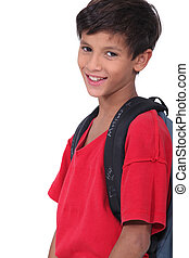Young schoolboy wearing a large rucksack