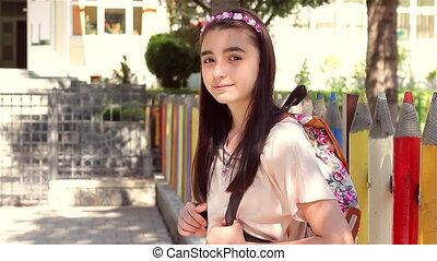 Young schoolgirl back to school