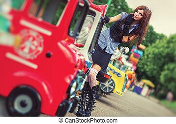Young schoolgirl in amusement park
