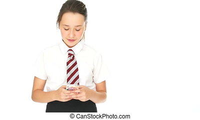 Young schoolgirl sending an sms on her mobile