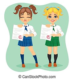 young schoolgirls showing exam with good and bad test...