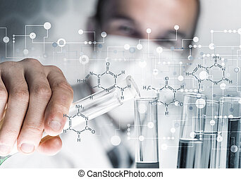 Young scientist mixing reagents in glass flask in clinical...