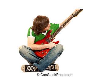 guitarist calibrating his electric guitar
