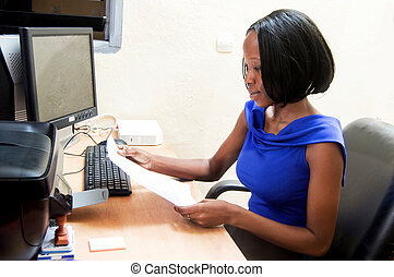 Young secretary woman in front of her computer.
