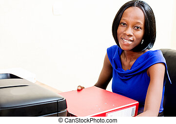 Young secretary woman sitting at her desk..