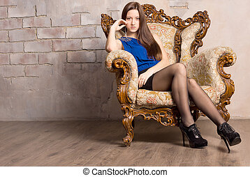 Young seductive brown haired woman posing