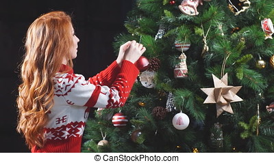 Young Seductive girl in red sweater decorated tree. - Young...