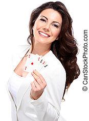 young seductive woman play poker