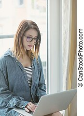 young self-employed woman with laptop - Portrait of young...