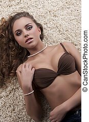 young sensual brunette wearing a brown bra