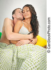 Young sensual couple in bed