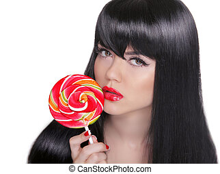 Young sensual girl sucking lollipop. Red lips. Makeup. Brunette