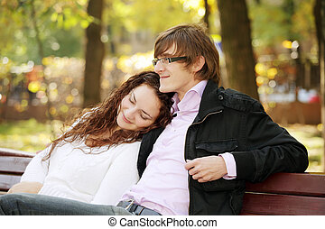 Young serene couple in park