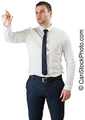 Young serious businessman pointing