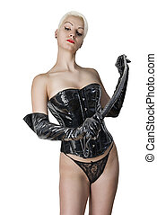 Young sexual dominatrix black with a whip in her hand. -...
