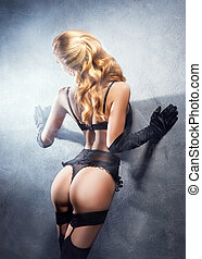 Young, sexy and beautiful blond girl in erotic lingerie.