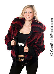Young sexy blond woman in a fur jacket