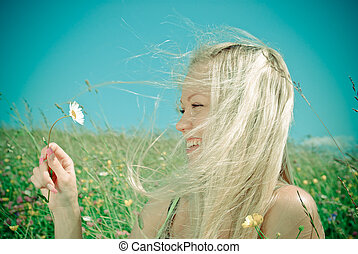 Young Sexy blonde on background of green meadow