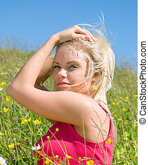 Young Sexy blonde on background of meadow