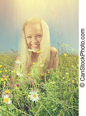 Young Sexy blonde on meadow with camomile