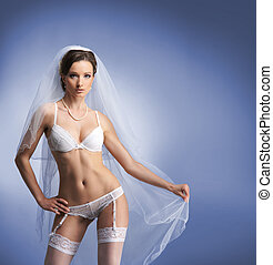 Young sexy bride in erotic lingerie over blue background.