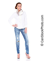 Young sexy brunette woman in white shirt and blue jeans