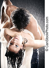 Young sexy couple passion. Water studio photo.
