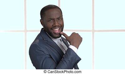Young sexy dark-skinned businessman. Macho-man surprised...
