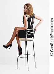 Young sexy girl blonde with bar chair