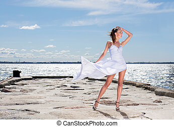 Young sexy girl in a white dress