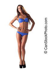 young sexy girl in blue bikini swimsuit