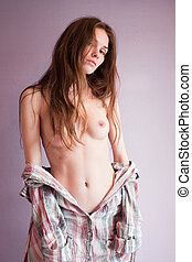 Young sexy girl topless in studio.