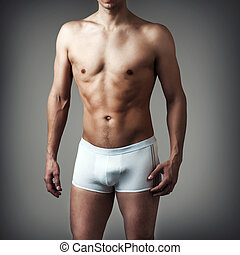 young sexy handsome man wearing white underwear